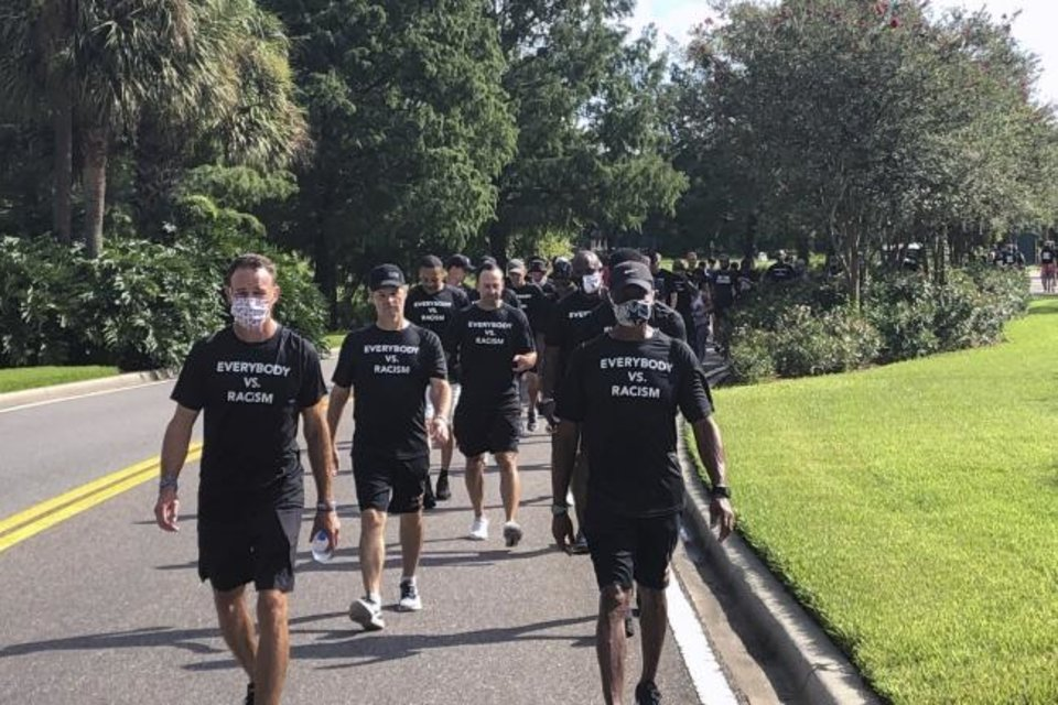 Photo -  NBA referees march in support of players seeking an end to racial injustice Thursday in Lake Buena Vista, Fla. Their march came shortly before players met to decide on restarting the season after three games were postponed Wednesday. [AP Photo/Brian Mahoney]