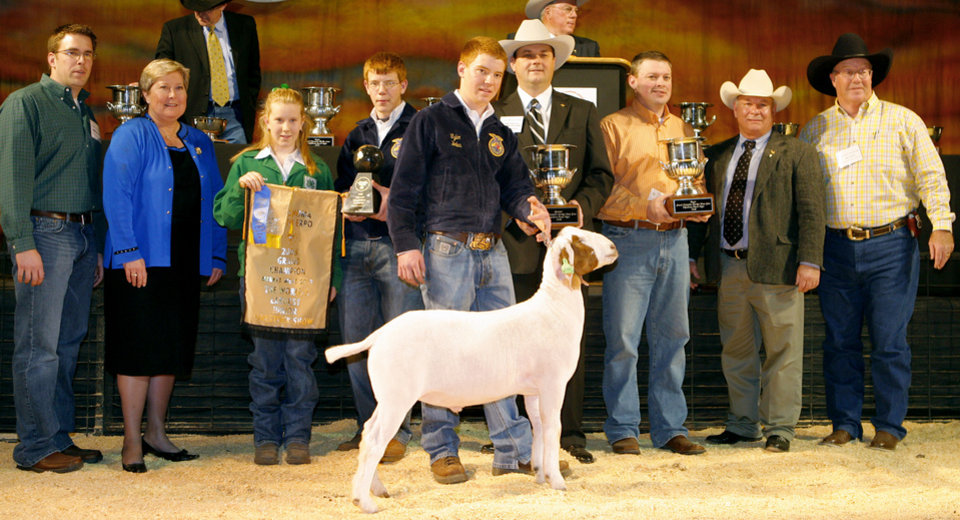 Photo - Grand champion goat winner Tyler Boles (center) with James Roller, Lt. Gov. Jari Askins, Chelsea Chambers, Trent Boles, John Grunewald, Fred Slater, Mike Spradling and Jim Matt during the Sale of Champions of the Oklahoma Youth Expo at State Fair Arena in Oklahoma City, Thursday, March 20, 2008. BY MATT STRASEN, THE OKLAHOMAN ORG XMIT: KOD