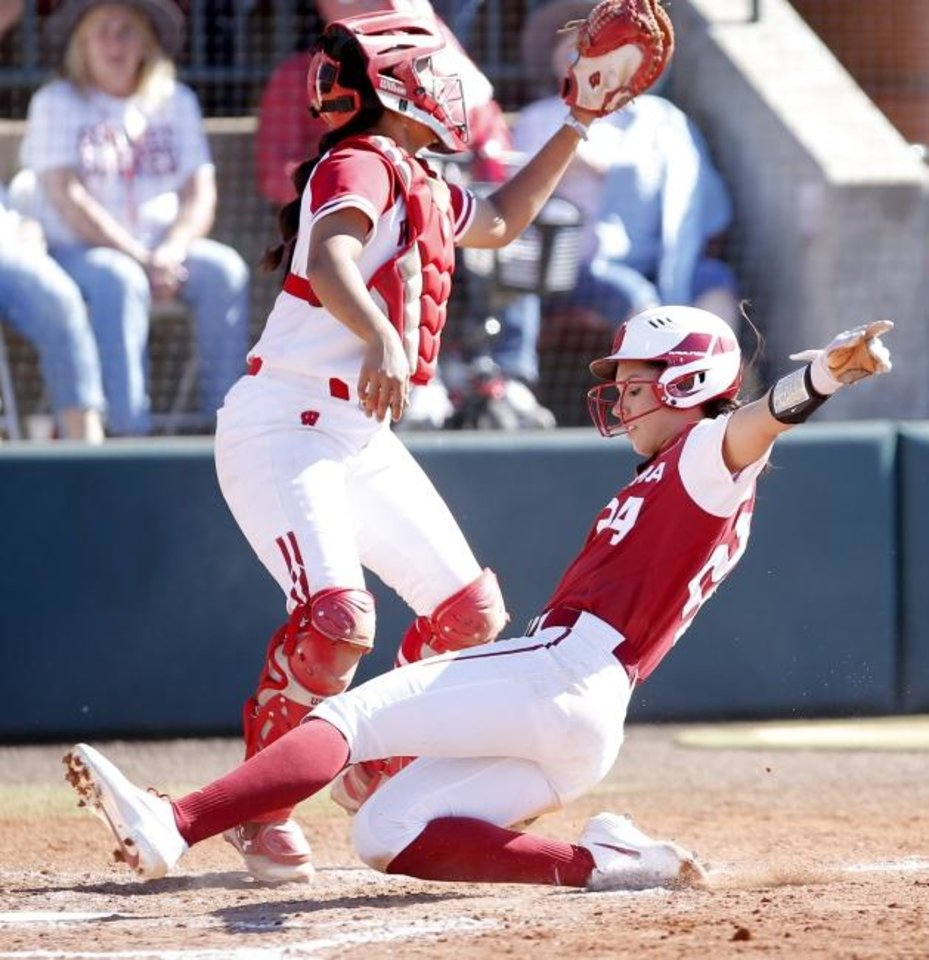Photo -  Oklahoma's Raegan Rogers slides home safely in the third inning of Sunday's regional elimination game against Wisconsin. OU went on to beat the Badgers 2-0 to advance to the Super Regionals. [Sarah Phipps/The Oklahoman]
