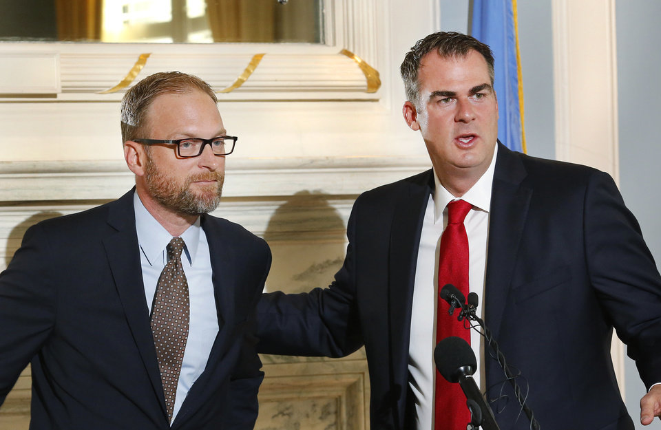 Photo - Gov. Kevin Stitt introduces Justin Brown during a press conference at the state Capitol Tuesday morning, June 4, 2019. The governor said Brown has been selected to run the Oklahoma Department of Human Services and replaces current DHS director Ed Lake.  Brown is the CEO of a company that has multiple assisted living facilities in Oklahoma and neighboring states.  