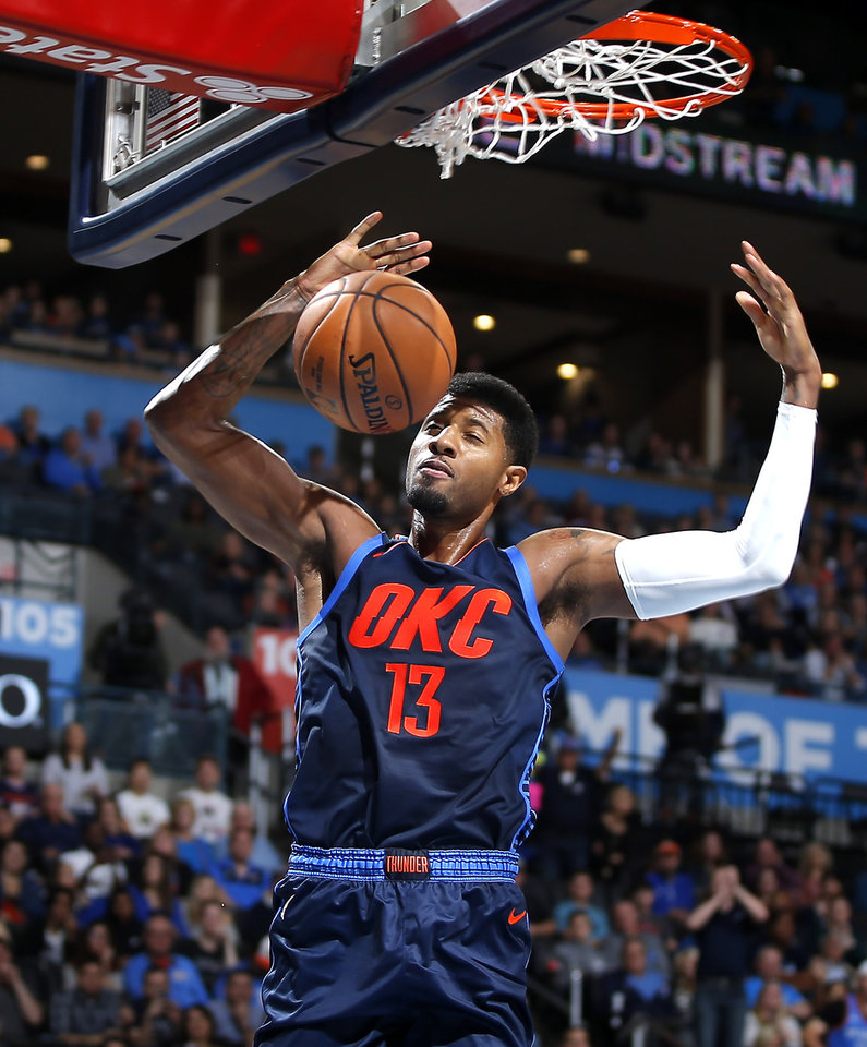 Photo - Oklahoma City's Paul George (13) dunks during an NBA basketball game between the Oklahoma City Thunder and the Sacramento Kings at Chesapeake Energy Arena in Oklahoma City, Sunday, Oct. 21, 2018. Photo by Bryan Terry, The Oklahoman