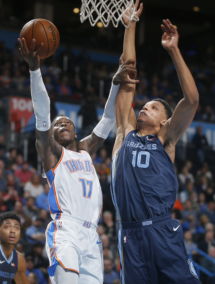 Photo - Oklahoma City's Dennis Schroder (17) goes to the basket beside Ivan Rabb (10) of Memphis during an NBA basketball game between the Oklahoma City Thunder and the Memphis Grizzlies at Chesapeake Energy Arena in Oklahoma City, Thursday, Feb. 7, 2019. Photo by Bryan Terry, The Oklahoman
