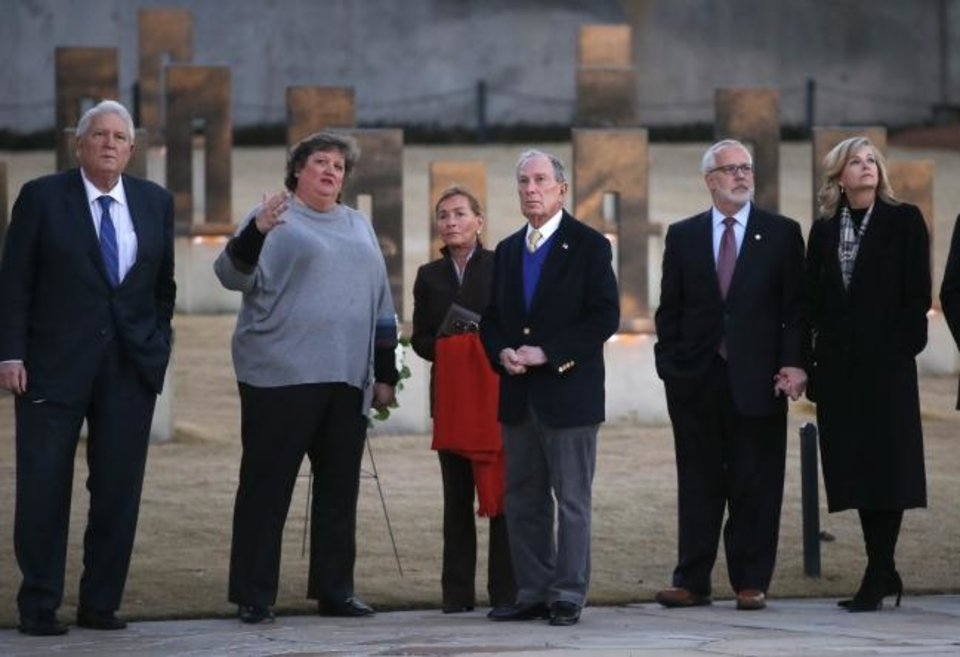 Photo -  Oklahoma City National Memorial and Museum Executive Director Kari Watkins talks with Democratic presidential candidate and former New York City Mayor Michael Bloomberg and Judge Judy Sheindlin, center, at the memorial Saturday. Also present are former Attorney General Mike Turpen, left, and former Gov. Brad Henry and his wife, Kim.  [Sarah Phipps/The Oklahoman]