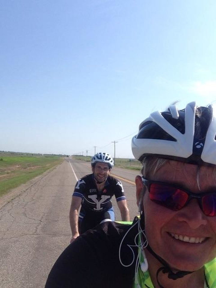 Photo - Daphne Summers and Matt Schullman ride together north of Enid on U.S. Highway 81. [Photo Provided]