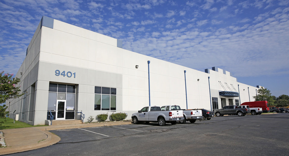 Photo -  Vanguard Development Co.'s 60,000-square-foot bulk warehouse at 9401 S Pole Road in Oklahoma City, built in 2001, is fully leased with three tenants in a property sector that saw vacancy rise from 8.7 percent to 12.2 percent the past year: Carpenter Co., which makes mattress foam, 30,000 square feet; Wheel Pros, which makes wheels for cars, trucks and other vehicles, 20,000 square feet; and Binswanger Glass, a custom glass manufacturer, 10,000 square feet. [PHOTO BY STEVE GOOCH, THE OKLAHOMAN]