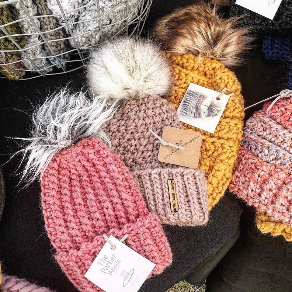 Photo -  Items from The Crochet Cabinet, owned by Savannah Shirley, are displayed. Shirley is a teacher in Woodward who is bringing products like these as part of The Holly Jolly Shops opening in Bricktown Ballpark on Dec. 8 and 9. [Photos submitted]