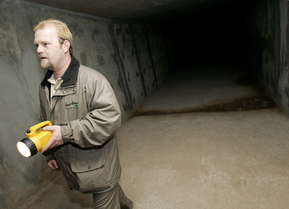 A Downtown Oklahoma City Inc. operations employee surveys an unfinished  segment of The Underground that crosses under Hudson Avenue in this 2006  photo.