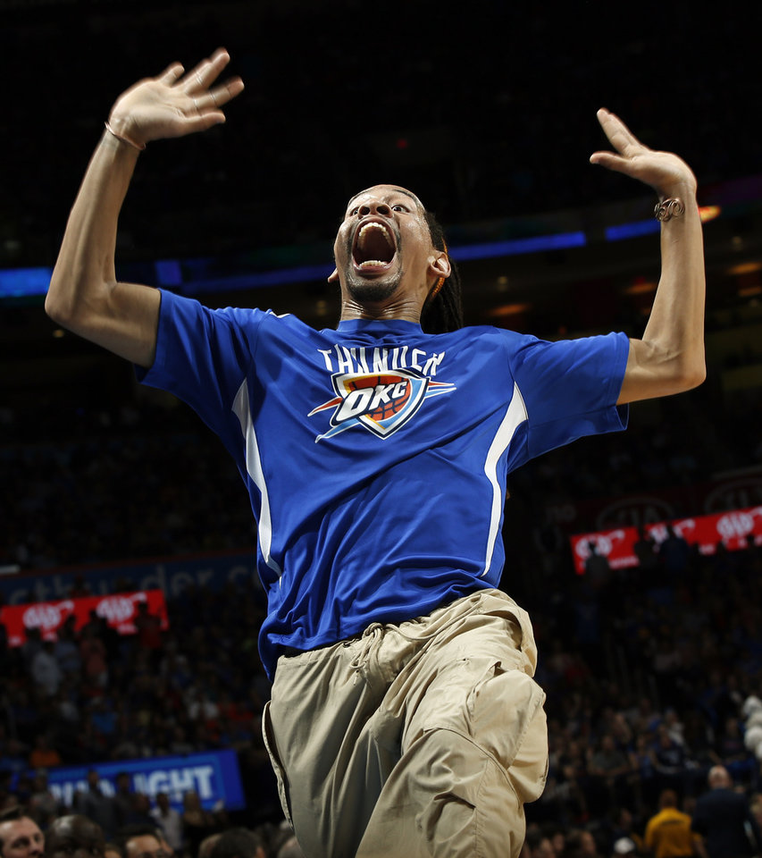 Photo - A member of the Storm Chasers hypes up the crowd during an NBA basketball game between the Oklahoma City Thunder and the Golden State Warriors at Chesapeake Energy Arena in Oklahoma City, Saturday, Feb. 27, 2016. Golden State won 121-118 in overtime. Photo by Nate Billings, The Oklahoman