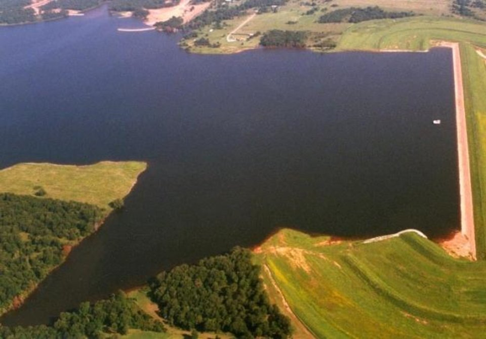 Photo -  The watershed dam shown in this picture, North Deer Creek Watershed Dam No. 1 in Pottawatomie County, is one of the larger ones in Oklahoma. It is also known as the Wes Watkins Reservoir. [Oklahoma Conservation Commission photo]