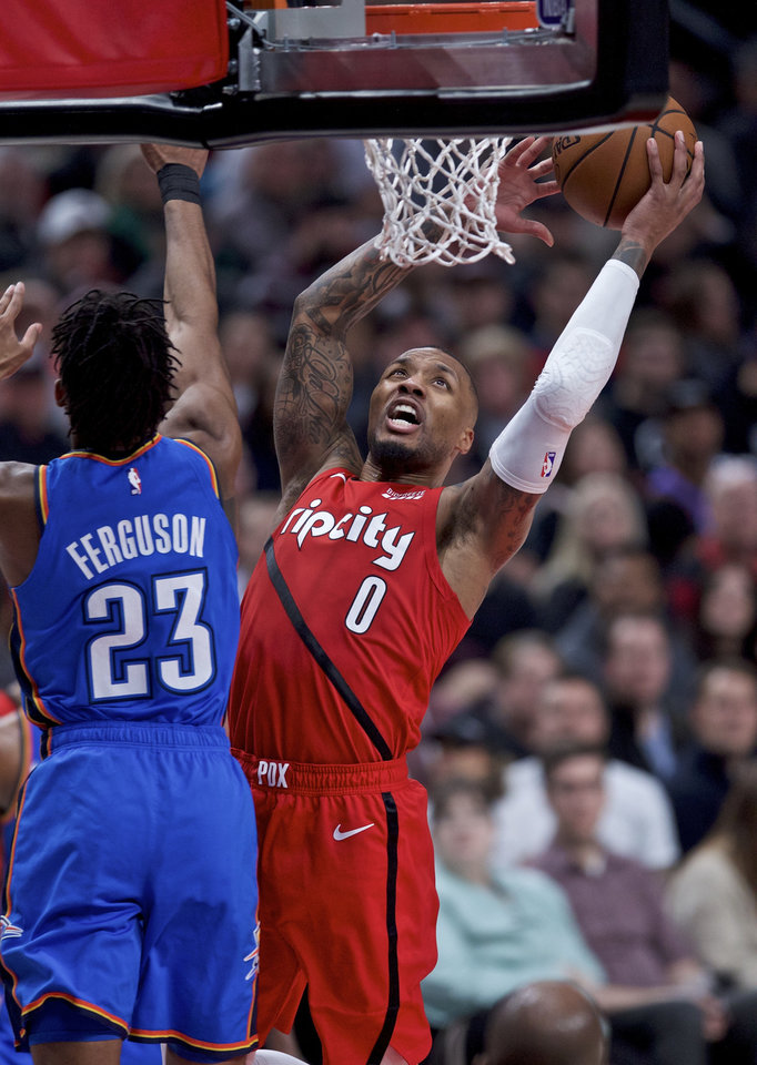 Photo - Portland Trail Blazers guard Damian Lillard, right, shoots over Oklahoma City Thunder guard Terrance Ferguson during the second half of an NBA basketball game in Portland, Ore., Friday, Jan. 4, 2019. (AP Photo/Craig Mitchelldyer)