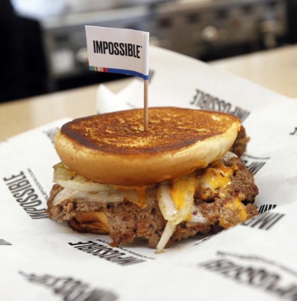 Photo -  The plant-based Impossible Melt is seen at Wayback Burgers in Edmond. [Nate Billings/The Oklahoman]