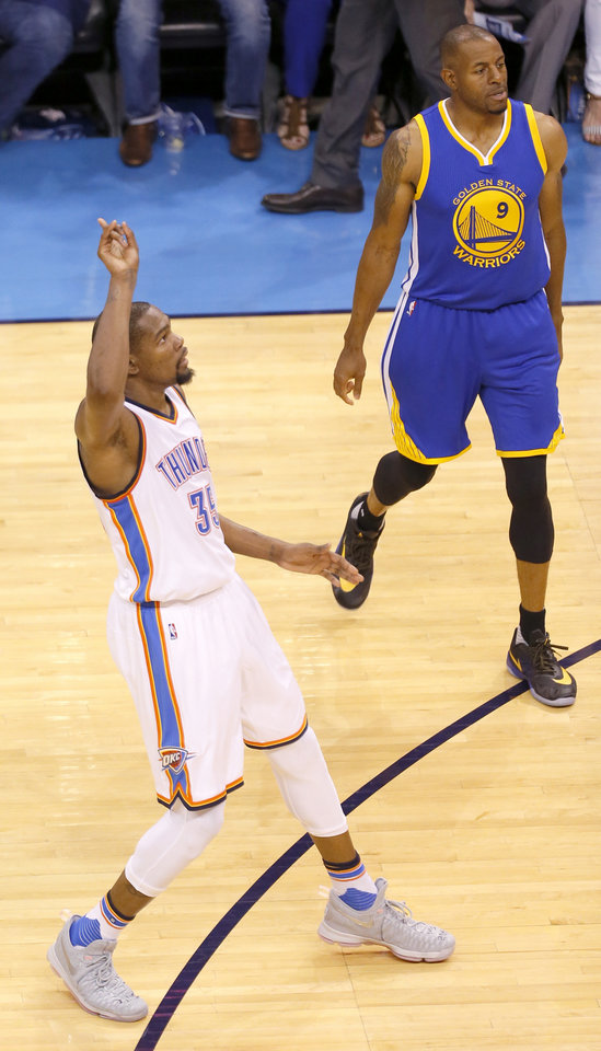 Photo - Oklahoma City's Kevin Durant (35) celebrates a 3-point basket in front of Golden State 's Andre Iguodala (9) during Game 3 of the Western Conference finals in the NBA playoffs between the Oklahoma City Thunder and the Golden State Warriors at Chesapeake Energy Arena in Oklahoma City, Sunday, May 22, 2016. Photo by Sarah Phipps, The Oklahoman