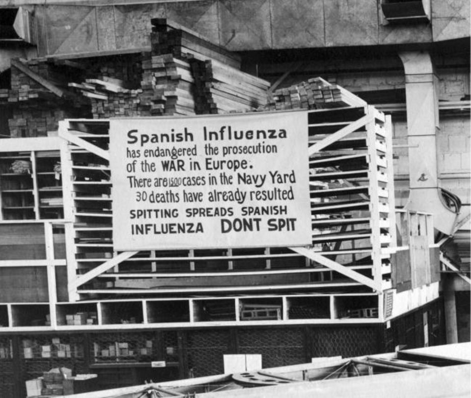 Photo -  In this Oct. 19, 1918, photo provided by the U.S. Naval History and Heritage Command, a sign is posted at the Naval Aircraft Factory in Philadelphia that indicates the Spanish Influenza was then extremely active. [U.S. Naval History and Heritage Command via AP]