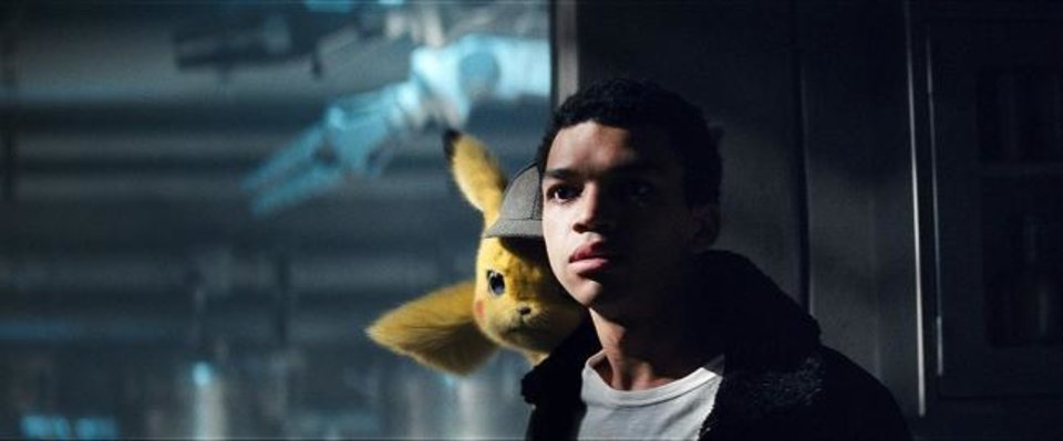 Photo -  Ryan Reynolds provides the voice of an exceptionally chatty Pikachu and Justice Smith plays Tim, a former Pokemon trainer searching for his father, in