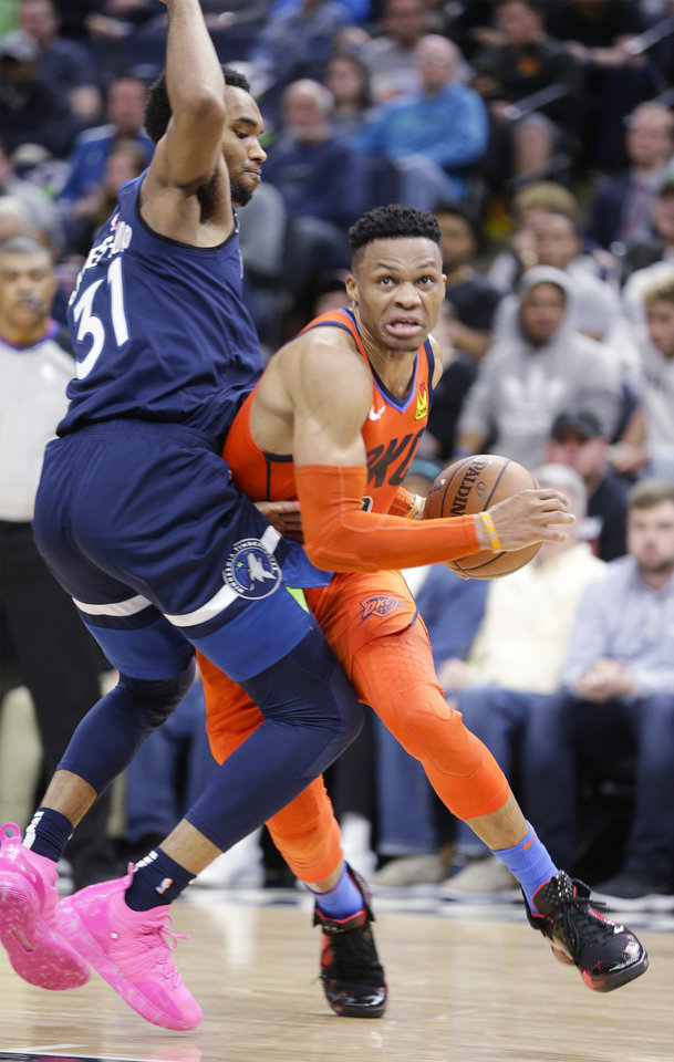 Photo - Oklahoma City Thunder guard Russell Westbrook (0) drives around Minnesota Timberwolves forward Keita Bates-Diop (31) during the second half of a NBA basketball game Sunday, April 7, 2019, in Minneapolis. Westbrook had a triple-double on the day as Oklahoma City won 132-126. (AP Photo/Paul Battaglia)