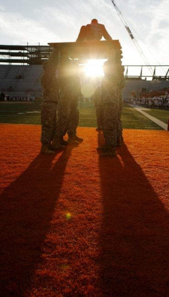 Photo -  A ROTC member does pushups after an Oklahoma State touchdown in 2007. [OKLAHOMAN ARCHIVES]
