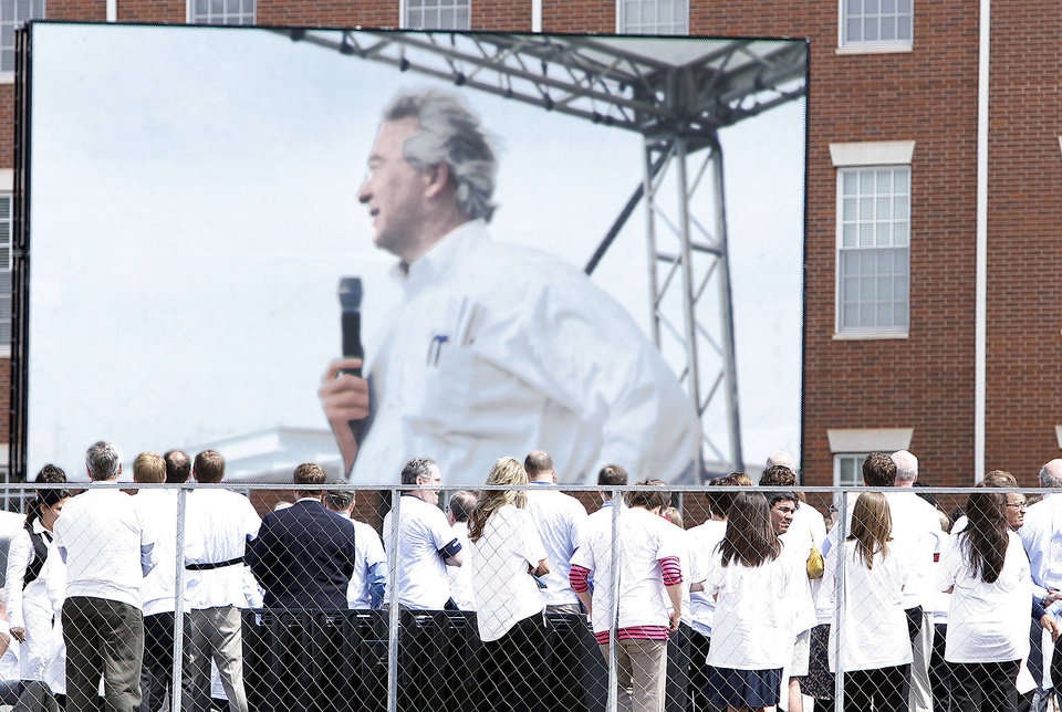 Photo - Chesapeake Energy employees gather to send off outgoing CEO Aubrey McClendon on Thursday at the company's Oklahoma City campus.  Photo By Steve Gooch, The Oklahoman