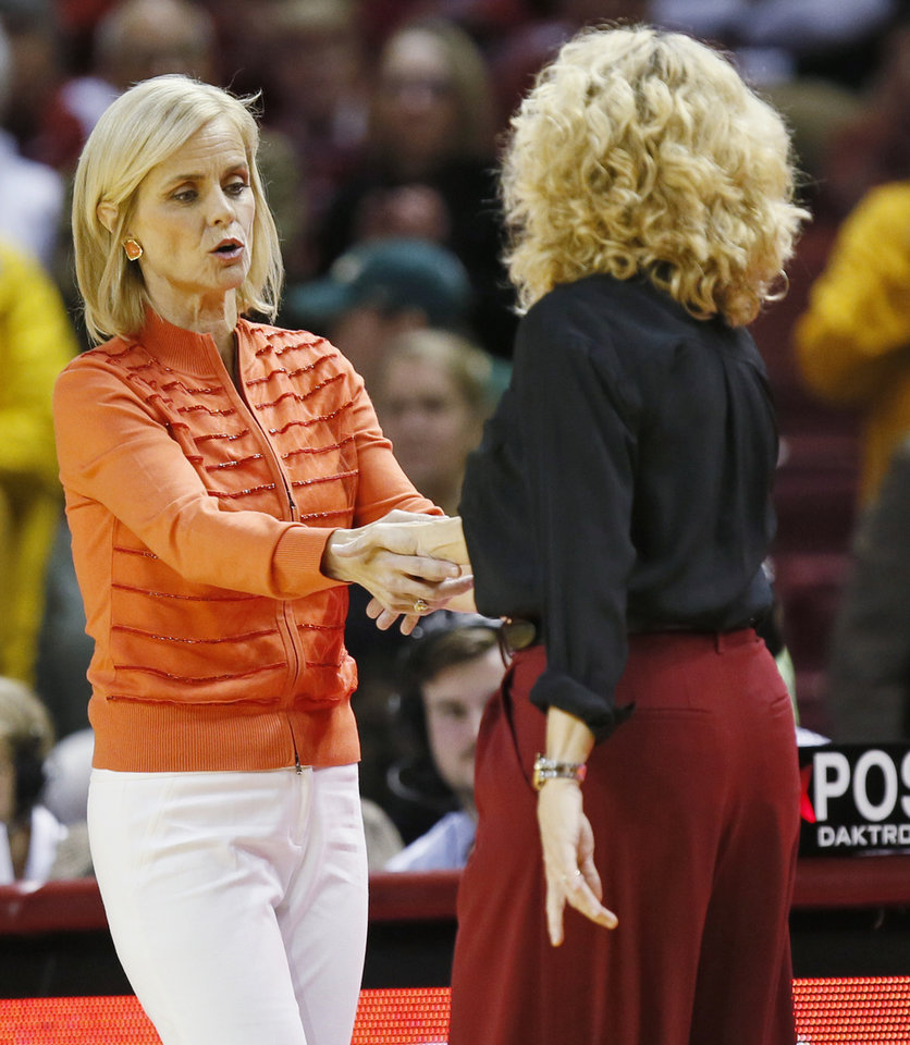 Photo - Baylor coach Kim Mulkey, left, and Oklahoma coach Sherri Coale shake hands after a women's college basketball game between the Oklahoma Sooners (OU) and Baylor Lady Bears at Lloyd Noble Center in Norman, Okla., Monday, Feb. 27, 2017. Baylor won 103-64. Photo by Nate Billings, The Oklahoman