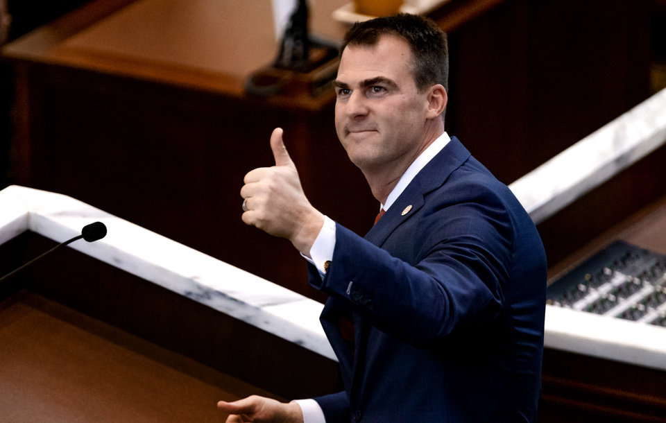 Photo - Gov. Kevin Stitt gives a thumbs up to the gallery as he delivers his State of the State Address in the House Chambers of the Oklahoma House of Representative in Oklahoma City, Okla. on Monday, Feb. 3, 2020.  [Chris Landsberger/The Oklahoman]