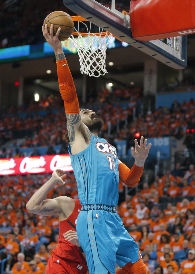 Photo - Oklahoma City's Steven Adams (12) goes to the basket during Game 3 in the first round of the NBA playoffs between the Portland Trail Blazers and the Oklahoma City Thunder at Chesapeake Energy Arena in Oklahoma City, Friday, April 19, 2019. Photo by Bryan Terry, The Oklahoman