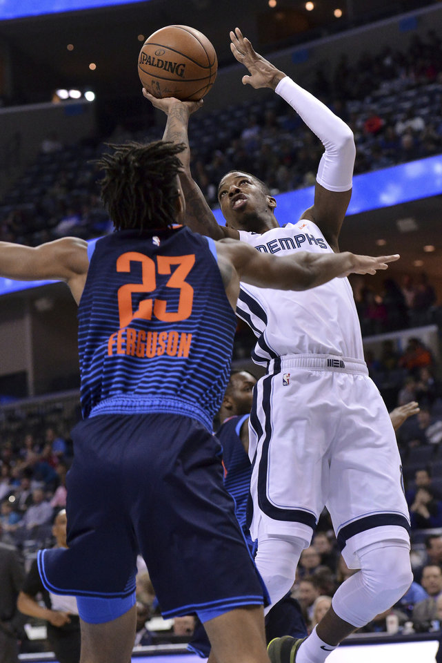 Photo - Memphis Grizzlies guard Delon Wright shoots over Oklahoma City Thunder guard Terrance Ferguson (23) during the first half of an NBA basketball game Monday, March 25, 2019, in Memphis, Tenn. (AP Photo/Brandon Dill)