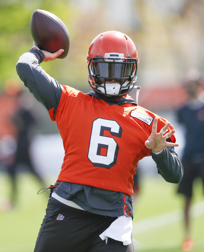 Photo - Cleveland Browns' Baker Mayfield throws a pass during an NFL football organized team activity session at the team's training facility Wednesday, May 15, 2019, in Berea, Ohio. (AP Photo/Ron Schwane)