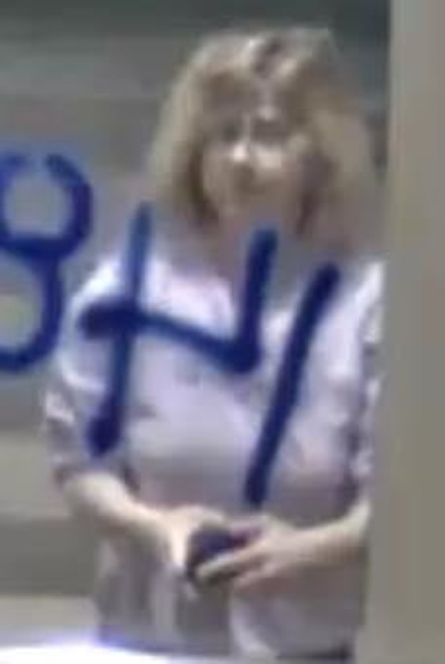 Photo -  Oklahoma City police on Thursday released this image from surveillance video of a woman who is wanted for questioning in connection with the racist and homophobiic graffiti painted on two Oklahoma City buildings. [PROVIDED]