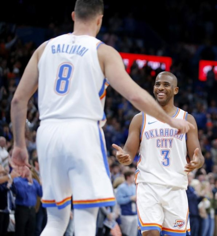 Photo -  Chris Paul (3) smiles as he walks to Danilo Gallinari (8) after a steal in the final minute of the Thunder's 106-101 win against Dallas on Tuesday. [Bryan Terry/The Oklahoman]