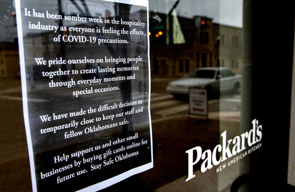 Photo - The sign letting customers know that Packard's New American Kitchen restaurant in Oklahoma City, Okla. made the decision to close in effort to prevent the spread of the coronavirus on Tuesday, March 17, 2020. The restaurant [Chris Landsberger/The Oklahoman]