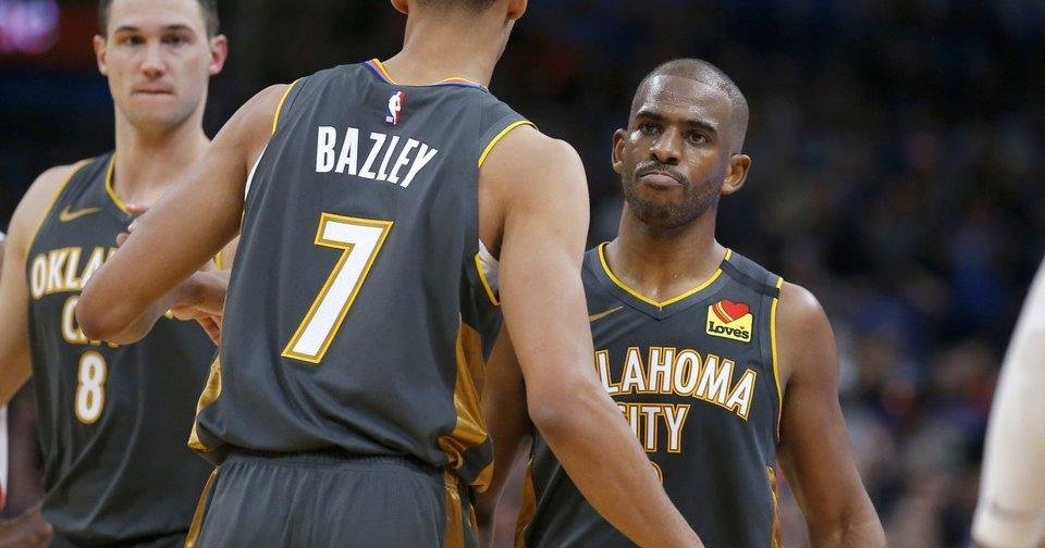 Photo - Oklahoma City's Chris Paul (3) celebrates with Darius Bazley (7) in the fourth quarter during the NBA basketball game between the Oklahoma City Thunder and the Houston Rockets at the Chesapeake Energy Arena in Oklahoma City,  Thursday, Jan. 9, 2020.  [Sarah Phipps/The Oklahoman]