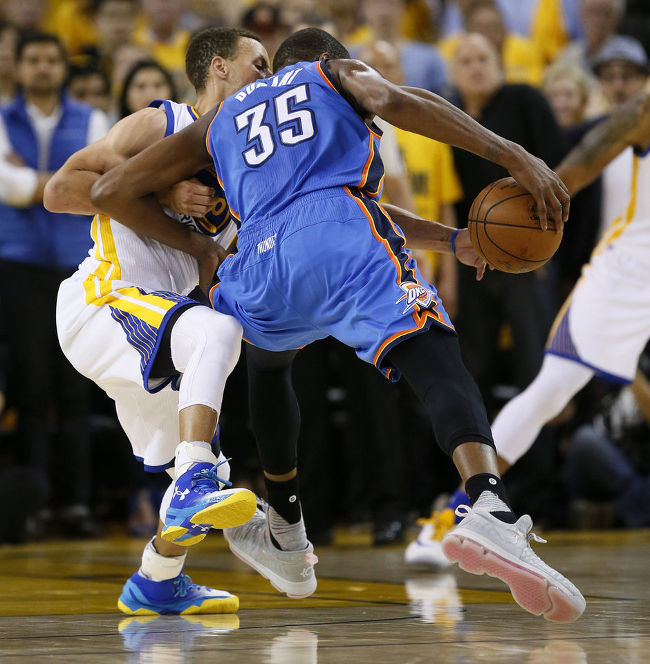 Photo - Golden State's Stephen Curry (30) steals the ball from Oklahoma City's Kevin Durant (35) in the fourth quarter during Game 5 of the Western Conference finals in the NBA playoffs between the Oklahoma City Thunder and the Golden State Warriors at Oracle Arena in Oakland, Calif., Thursday, May 26, 2016. The Warriors won 120-111. Photo by Nate Billings, The Oklahoman