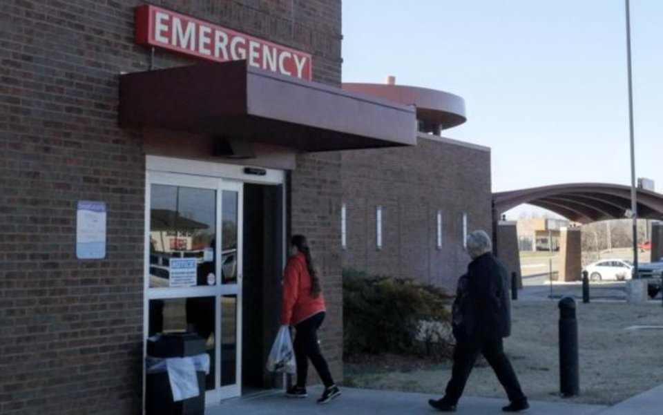 Photo -  Visitors enter an emergency room at a rural Oklahoma hospital. [Whitney Bryen/Oklahoma Watch]