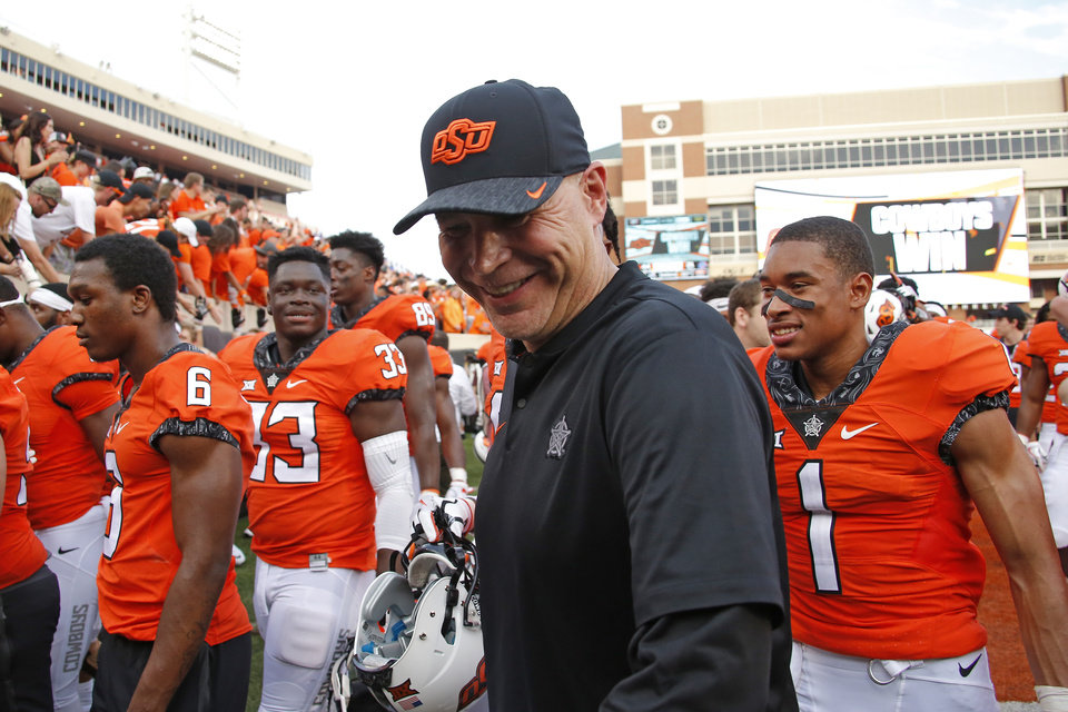 Photo - Oklahoma State defensive coordinator Jim Knowles walks off the field after a college football game between the Oklahoma State University Cowboys (OSU) and the Boise State Broncos at Boone Pickens Stadium in Stillwater, Okla., Saturday, Sept. 15, 2018. Oklahoma State won 44-21. Photo by Bryan Terry, The Oklahoman