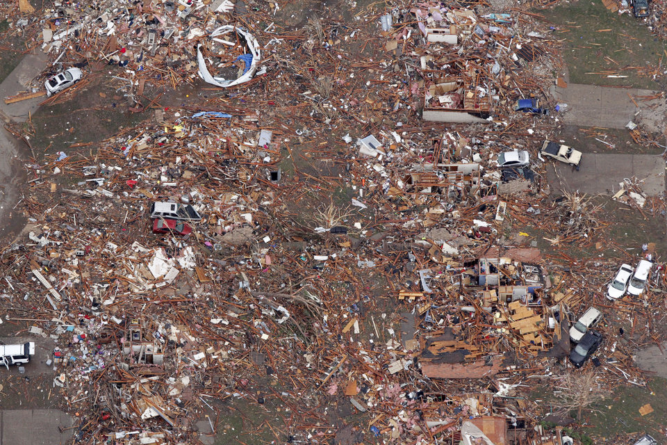 Photo - Piles of rubble are all that is left of homes hit by the May 20th tornado in Moore, OK, Tuesday, May 21, 2013,  By Paul Hellstern, The Oklahoman