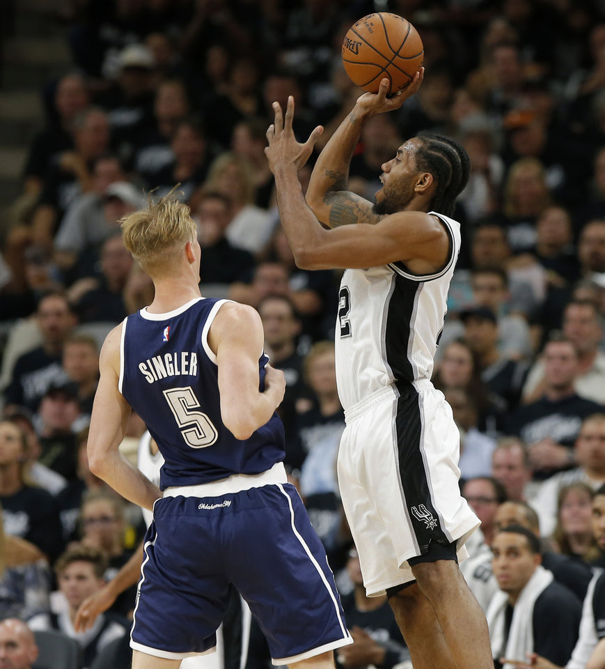 Photo - Oklahoma City's Kyle Singler (5) fouls San Antonio's Kawhi Leonard (2) on a 3-pointer during Game 1 of the second-round series between the Oklahoma City Thunder and the San Antonio Spurs in the NBA playoffs at the AT&T Center in San Antonio, Saturday, April 30, 2016. Photo by Bryan Terry, The Oklahoman