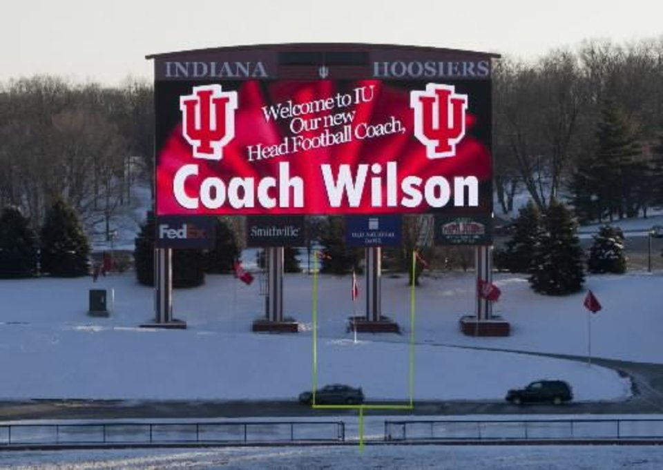 Photo -  A banner on the electronic monitor inside of Indiana's Memorial Stadium, on the day Kevin Wilson, outgoing offensive coordinator of Oklahoma, is announced as Indiana's football head coach at a press conference Tuesday, Dec., 7, 2010, in Bloomington, Ind. Photo by Robert Scheer/The Indianapolis Star