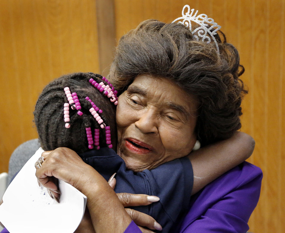 Photo - Thelma Parks returns the hug given her by a young student leaving the auditorium at the end of the assembly where Parks was honored. The school that bears her name, Thelma Parks Elementary School, is celebrating its 20th anniversary with special guests that included Parks,  a former teacher and school board member, and Thurman White Jr., a 2017 Foundation for Oklahoma City Public Schools Wall of Fame inductee who had Parks as a teacher. The event was held  in the school's auditorium on Thursday, Nov. 2, 2017.  Photo by Jim Beckel, The Oklahoman