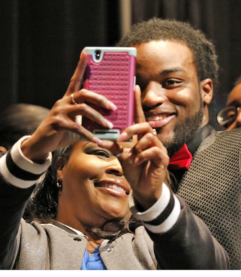 Photo - Douglass High School's Dameko Doddles, right poses for a selfie with Ericka Watson during a letter of intent signing ceremony  in Oklahoma City, Wednesday February, 04 2015. Doddles signed with Wyoming University. Photo By Steve Gooch, The Oklahoman