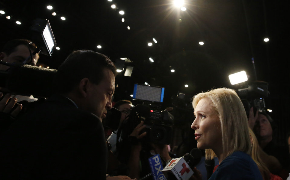 Photo - Democratic presidential candidate Sen. Kristen Gillibrand, D-NY., speaks in the spin room after the Democratic primary debate hosted by NBC News at the Adrienne Arsht Center for the Performing Art, Thursday, June 27, 2019, in Miami. (AP Photo/Brynn Anderson)
