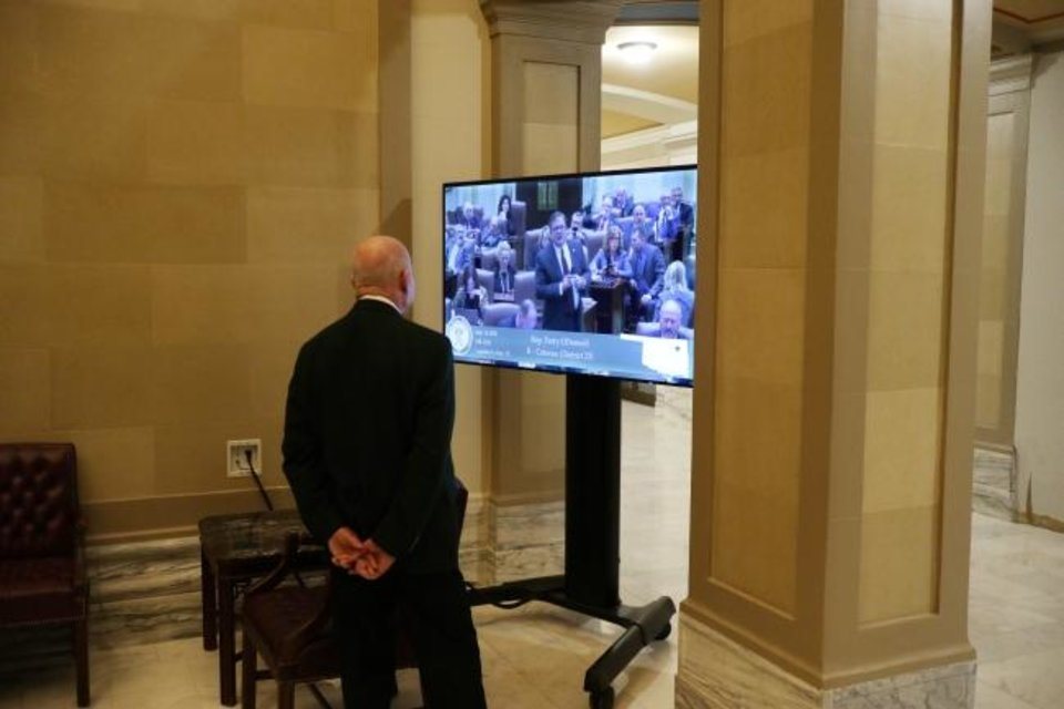 Photo -  The House has set up a large television so people can watch the session Monday. Access to the Capitol by the pulic will be limited as a measure to counter coronavirus spread. [Doug Hoke/The Oklahoman]