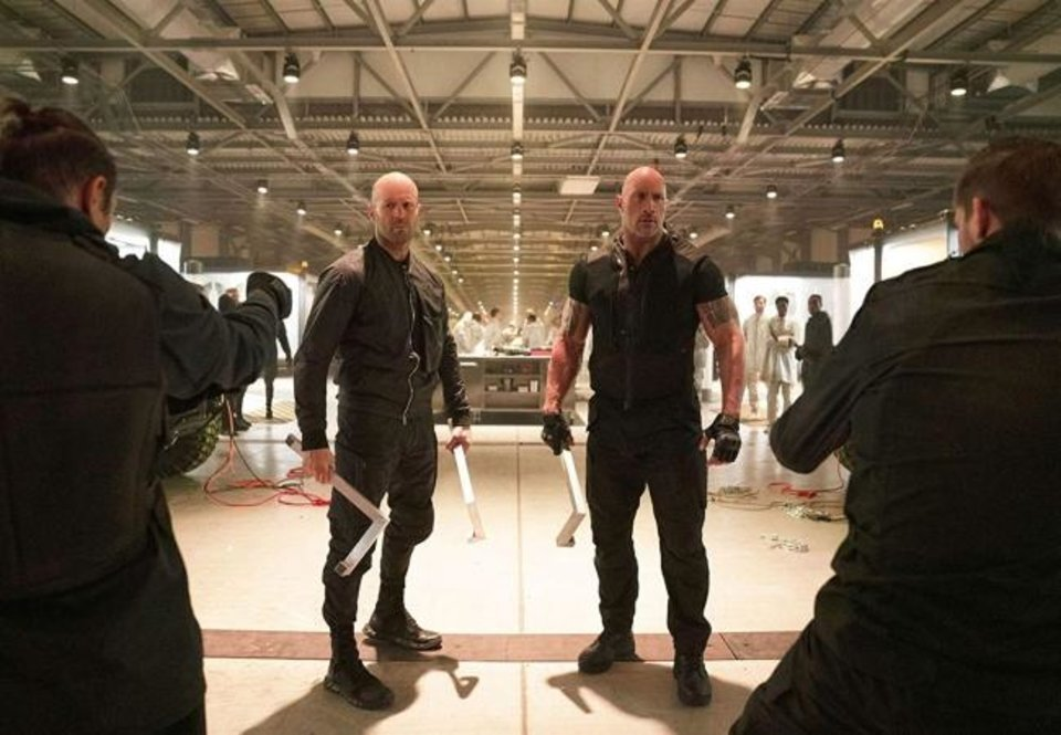 "Photo -  Jason Statham, left, and Dwayne Johnson star in ""Fast & Furious Presents: Hobbs and Shaw."