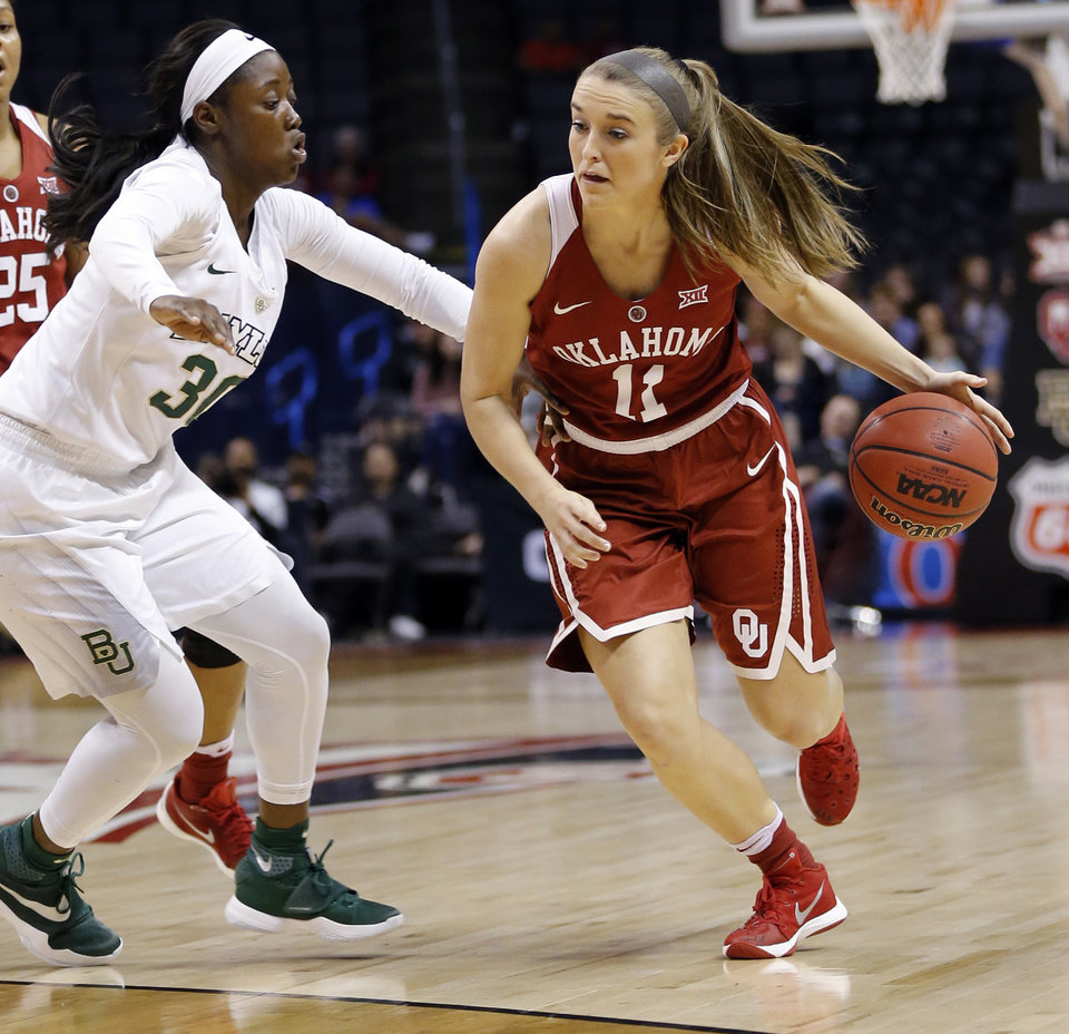 Photo - Oklahoma's Derica Wyatt (11) drives against Baylor's Alexis Jones (30) during a semifinal game in the Big 12 Women's Basketball Championship between the Oklahoma Sooners (OU) and the Baylor Lady Bears at Chesapeake Energy Arena in Oklahoma City, Sunday, March 6, 2016. Photo by Nate Billings, The Oklahoman