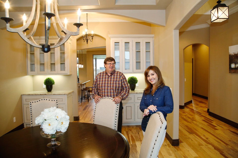 Spectacular JIM BECKEL THE OKLAHOMAN Photo Rick Gotcher operations manager for STK Homes and sales representative Mollie Barr