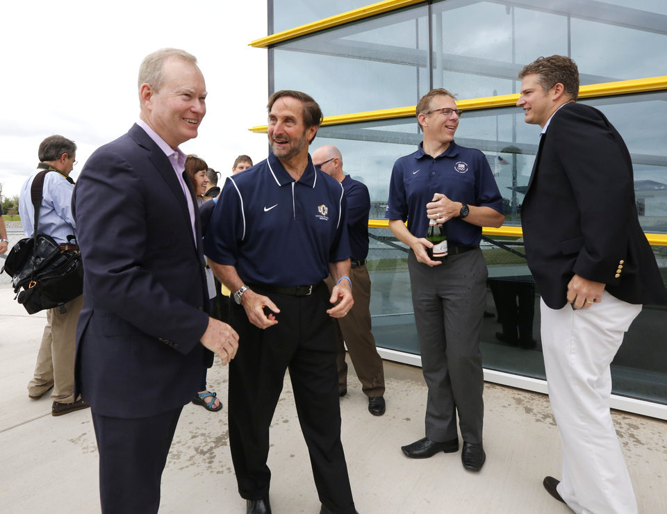 Photo - OKC Mayor Mick Cornett and University of Central Oklahoma President Don Betz talk during the Grand opening of the UCO boathouse on the Oklahoma River in Oklahoma City, OK, Saturday, April 18, 2015.  Photo by Paul Hellstern, The Oklahoman