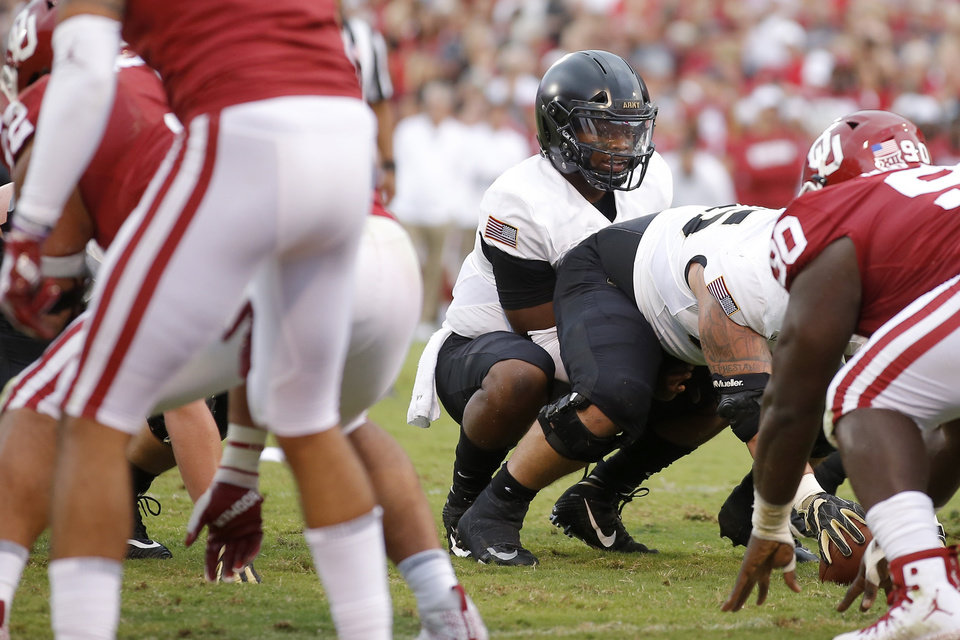 Photo - Army's Kelvin Hopkins Jr. (8) goes under center during a college football game between the University of Oklahoma Sooners (OU) and the Army Black Knights at Gaylord Family-Oklahoma Memorial Stadium in Norman, Okla., Saturday, Sept. 22, 2018. Photo by Bryan Terry, The Oklahoman