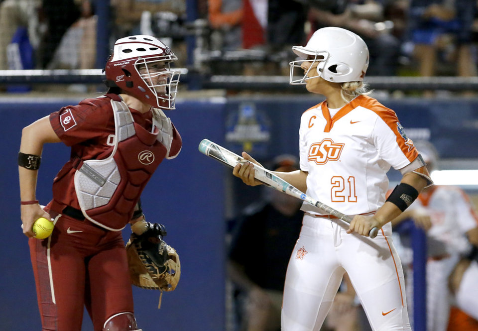 Photo - Oklahoma's Lynnsie Elam (22) celebrates after Oklahoma State's Sydney Pennington (21) strikes out in the 5th inning during a Women's College World Series between Oklahoma State (OSU) and Oklahoma at USA Softball Hall of Fame Stadium in Oklahoma City,  Friday, May 31, 2019.  [Sarah Phipps/The Oklahoman]