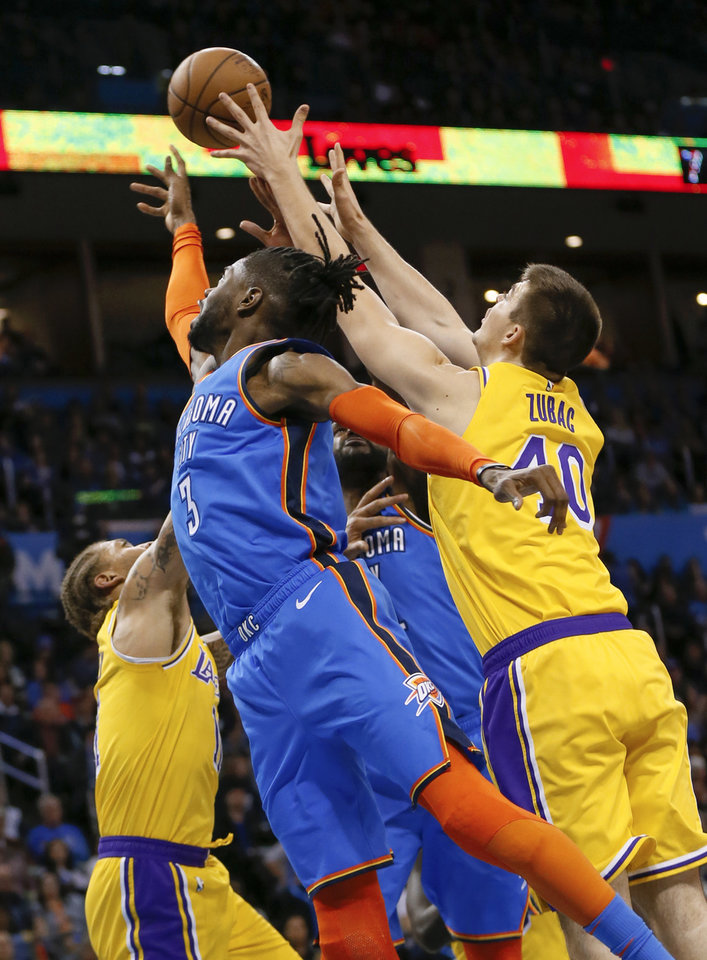 Photo - Oklahoma City's Nerlens Noel (3) chases a rebound next to Los Angeles' Ivica Zubac (40) and Michael Beasley (11) during an NBA basketball game between the Los Angeles Lakers and the Oklahoma City Thunder at Chesapeake Energy Arena in Oklahoma City, Thursday, Jan. 17, 2019. Photo by Nate Billings, The Oklahoman