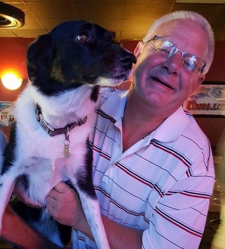 Photo -  Pat Canada, shown with his dog, Lexie, travels extensively for his job as the Oklahoma City-based district manager for Idaho-based PetIQ. His employer has not canceled any trips so far, he said. [PROVIDED]