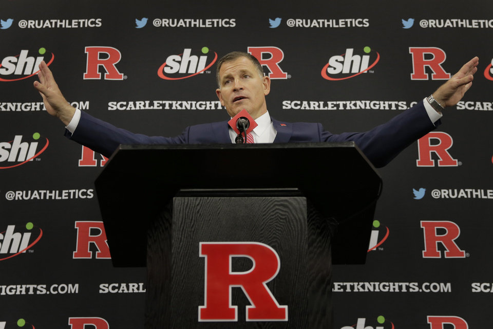 Photo - New Rutgers NCAA college football head coach Greg Schiano speaks at an introductory news conference in Piscataway, N.J., Wednesday, Dec. 4, 2019. After an on-again, off-again courtship, Greg Schiano is back as Rutgers football coach. (AP Photo/Seth Wenig)