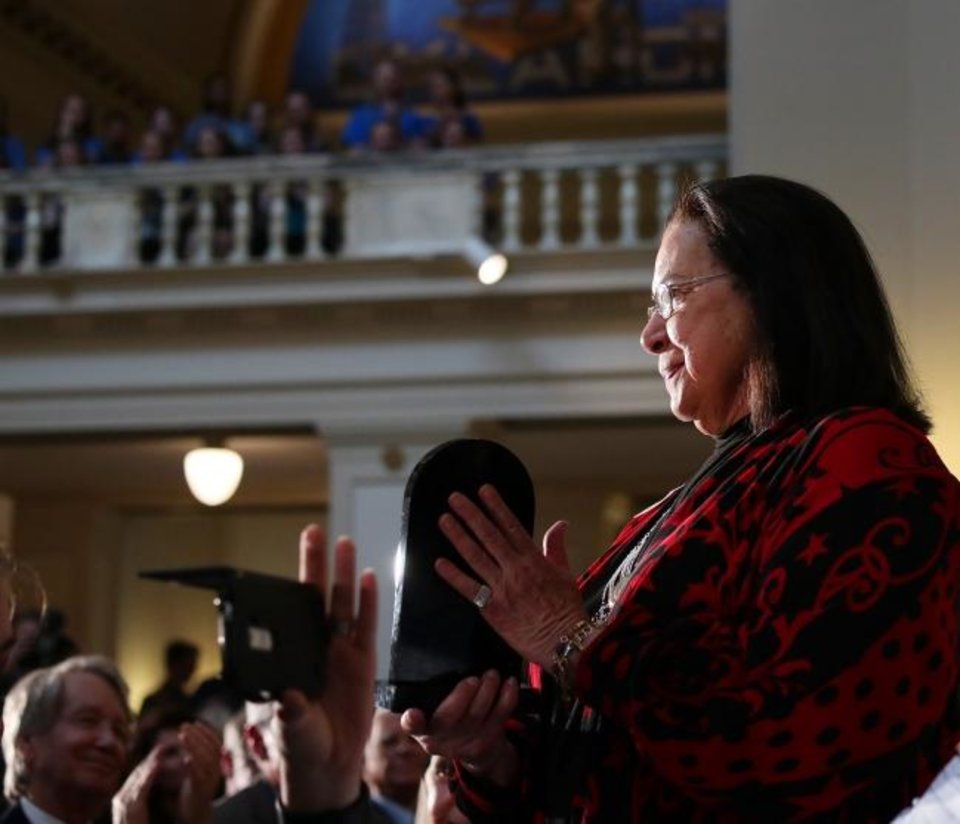 Photo -  Cherokee mezzo-soprano Barbara McAlister shows her Governor's Award to the crowd on April 16 at the Governor's Arts Awards at the Capitol. [Doug Hoke/The Oklahoman Archives]